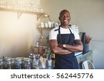 young black male in apron...   Shutterstock . vector #562445776