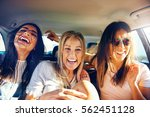 three vivacious girlfriends on... | Shutterstock . vector #562451128