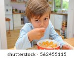 young boy is having cereals for ... | Shutterstock . vector #562455115