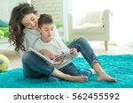 mom reads with a child | Shutterstock . vector #562455592