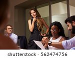 female boss stands thinking at