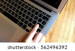 woman office worker is pressing ... | Shutterstock . vector #562496392