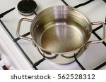 pan of boiling water on the gas ... | Shutterstock . vector #562528312