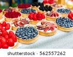 fruit and berry tarts dessert...   Shutterstock . vector #562557262
