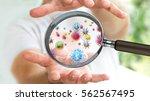 close up on a sick man hand... | Shutterstock . vector #562567495