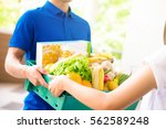 delivery man delivering food to ... | Shutterstock . vector #562589248