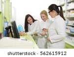 three happy female pharmacists... | Shutterstock . vector #562615912