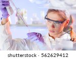 life scientists researching in... | Shutterstock . vector #562629412