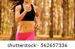 young woman running on the... | Shutterstock . vector #562657336