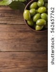 Small photo of . Green olives and branch of bay leaf. Bay leaf. Copyspace