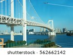 rainbow bridge with airplane... | Shutterstock . vector #562662142