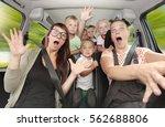 crazy family taking a selfie... | Shutterstock . vector #562688806