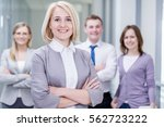 successful businesswoman with... | Shutterstock . vector #562723222