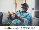 bearded african man enjoying... | Shutterstock . vector #562750162