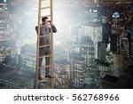 businessman with binoculars...   Shutterstock . vector #562768966