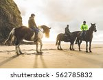 people with horses on the beach ... | Shutterstock . vector #562785832