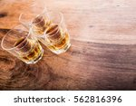 jager bombs on a wood table   Shutterstock . vector #562816396