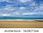 waves rolling in as the tide... | Shutterstock . vector #562827166