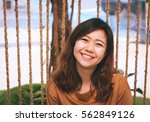 close up of young pretty asian... | Shutterstock . vector #562849126