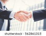 businessmen making handshake  ... | Shutterstock . vector #562861315