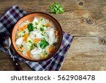 chicken soup with noodles and... | Shutterstock . vector #562908478