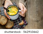 woman hands holding mug of... | Shutterstock . vector #562910662