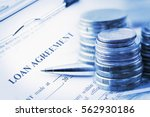 loan agreement with a blue... | Shutterstock . vector #562930186