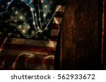 usa flag on a wood surface | Shutterstock . vector #562933672