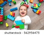 little baby playing with lots... | Shutterstock . vector #562956475