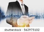 double exposure businessman... | Shutterstock . vector #562975102
