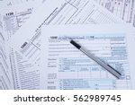 pen on us tax form background.... | Shutterstock . vector #562989745