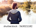 back of man looking at river ... | Shutterstock . vector #563021182