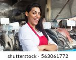 Happy Woman Selling Fresh Fish...