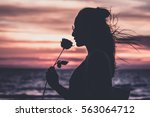 silhouette pretty young woman... | Shutterstock . vector #563064712