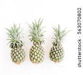 three pineapples on white... | Shutterstock . vector #563070802