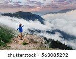young happy woman enjoying view ... | Shutterstock . vector #563085292
