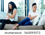 unhappy lesbian couple sitting... | Shutterstock . vector #563093572