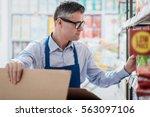 professional supermarket clerk... | Shutterstock . vector #563097106