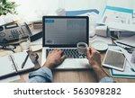 stressed businessman working in ... | Shutterstock . vector #563098282