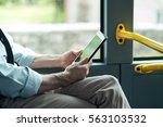 man commuting to work by bus... | Shutterstock . vector #563103532
