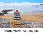 Zen Balancing Pebbles On Beach...