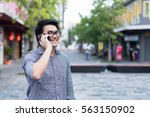asian man talking on smartphone ... | Shutterstock . vector #563150902