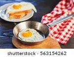 fried eggs in a frying pan.... | Shutterstock . vector #563154262
