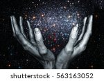 god's hands holding a star... | Shutterstock . vector #563163052