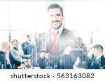 successful team leader and... | Shutterstock . vector #563163082
