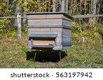 single wooden beehive in a... | Shutterstock . vector #563197942