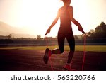 young woman skipping rope... | Shutterstock . vector #563220766