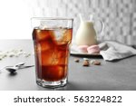 glass of cold coffee on table | Shutterstock . vector #563224822