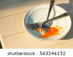dirty dishes on the table | Shutterstock . vector #563246152