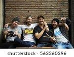 adult men sit together... | Shutterstock . vector #563260396